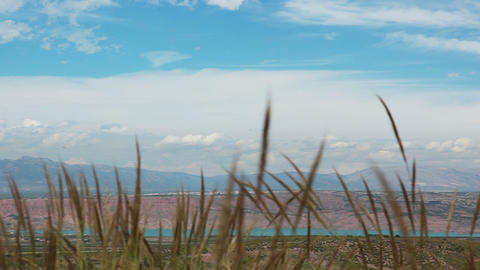 Landscape With Grass, Mountains And Sky stock footage