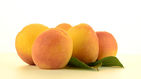 Four peaches rotating Stock Video Footage