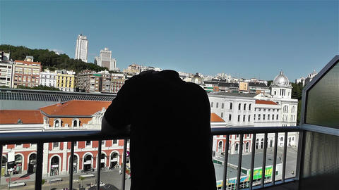Despaired Man on Balcony 4 Stock Video Footage