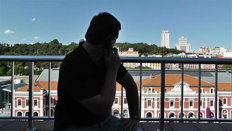 Man Talking Phone in Balcony 2 Footage