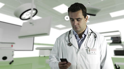 Young Doctor Cell Phone Operation Room 2 Stock Video Footage
