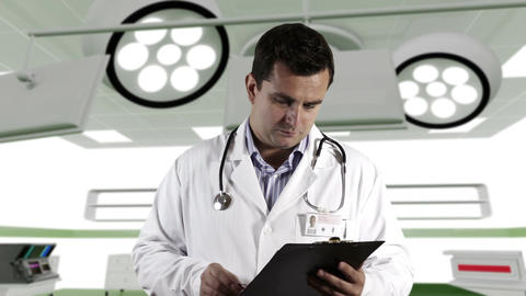 Young Doctor Checking and Signs Papers Operation R Stock Video Footage
