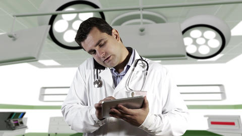 Young Doctor Tablet PC Cell Phone Operation Room 1 Stock Video Footage