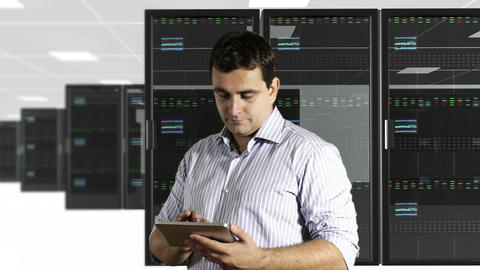 Young Man Tablet PC CPU Server Unit Room 3 Stock Video Footage