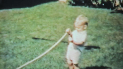 Boy Playing With Garden Hose 1963 Vintage 8mm film Footage