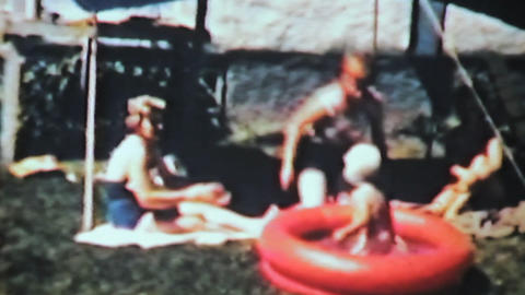 Boy Swimming In Kiddie Pool 1963 Vintage 8mm film Stock Video Footage