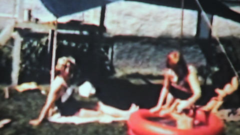 Boy Swimming In Kiddie Pool 1963 Vintage 8mm Film stock footage