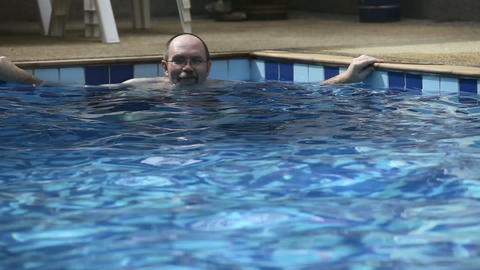 Man in pool Stock Video Footage
