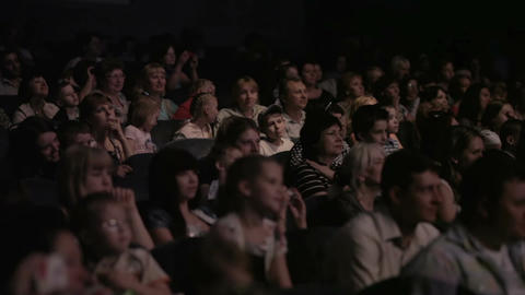 Children watching a show at the theatre 1 Stock Video Footage