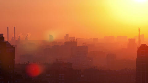 Sunrise over the city. Time lapse with panning Footage