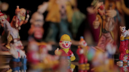 Clown figurines and clock Stock Video Footage