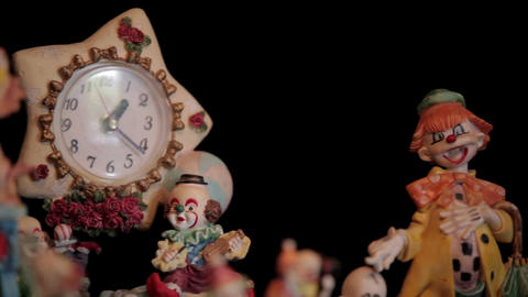 Clown figurines and clock Footage