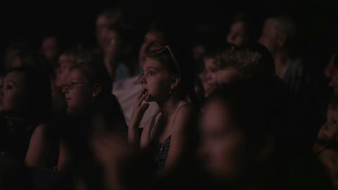 Girl in cinema or theatre Stock Video Footage