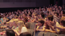 Audience applauded in theater or in cinema. Pan 2 Stock Video Footage