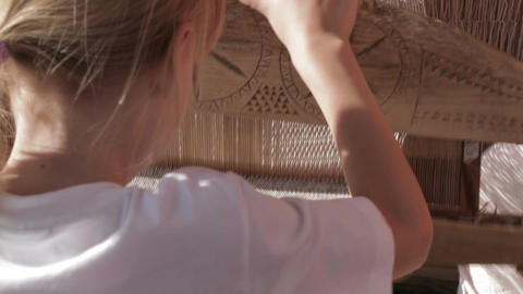 Girl working with traditional loom Stock Video Footage