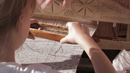 Girl Working With Traditional Loom stock footage
