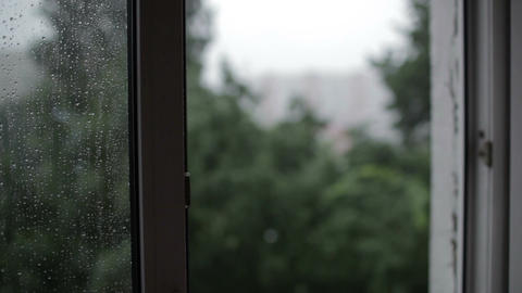 Heavy rain. Focus pulling from window to the build Stock Video Footage