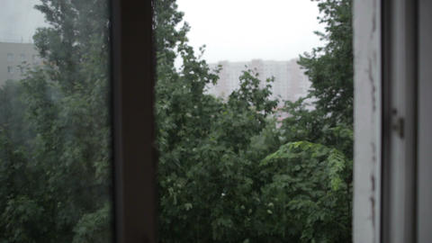 Heavy rain. Focus pulling from window to the build Footage
