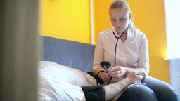 Doctor measures the blood pressure at home Footage