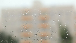 Focus pulling from glass with rain drops to the bu Stock Video Footage