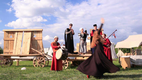 Folk musicians and woman dancer 1 Stock Video Footage