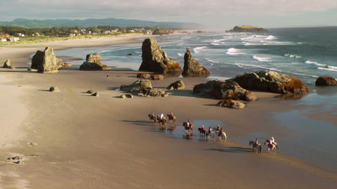 Horseback riding on Bandon Beach Stock Video Footage