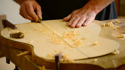Luthier hands making a guitar Footage