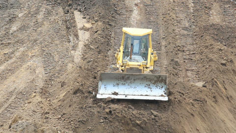 Yellow Bulldozer Raking Clay Footage