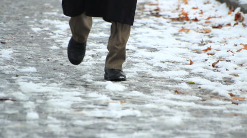 Pedestrians in snow Stock Video Footage