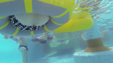 People swim on the inflatable circles in the water Footage