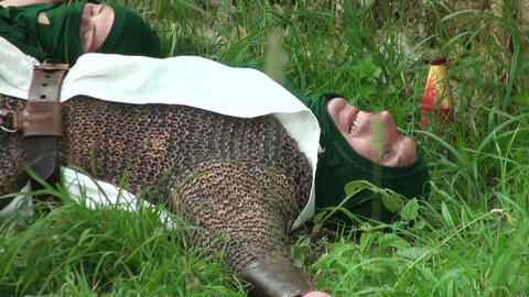 Warrior in chainmail lying on the grass Footage