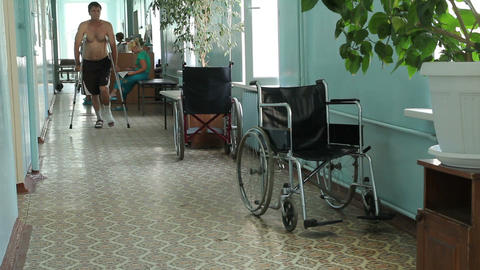 A man on crutches in the hospital Stock Video Footage