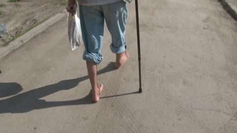 Bare feet are on the asphalt Footage