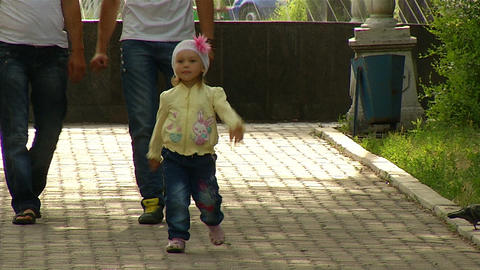 Funny Little Girl Walking In The Park stock footage