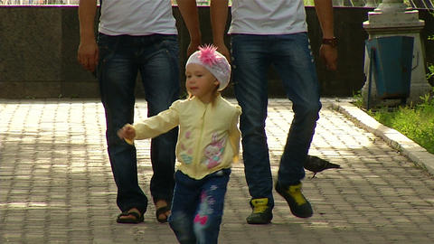 Funny little girl walking in the Park Stock Video Footage