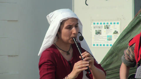 Young woman playing the flute Stock Video Footage