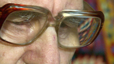 Eyes of an elderly man in glasses Footage