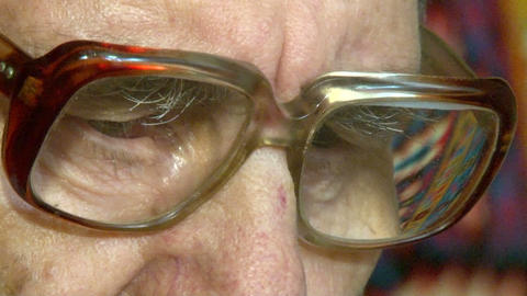 Eyes of an elderly man in glasses Stock Video Footage