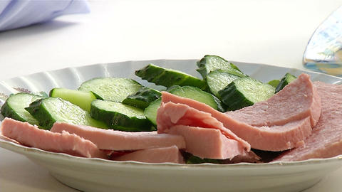 Sliced sausages and cucumbers on a plate Stock Video Footage