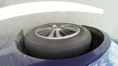 Car wheel rolling on asphalt Stock Video Footage