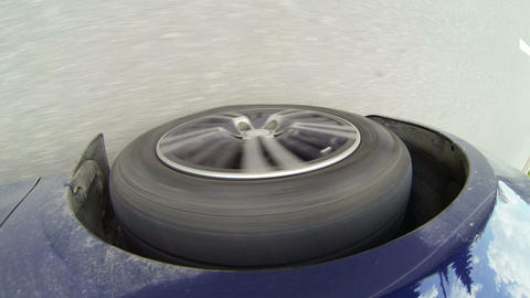 Car wheel rolling on asphalt Stock Video Footage