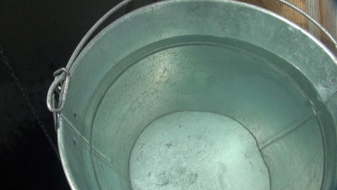 A bucket and a well Stock Video Footage