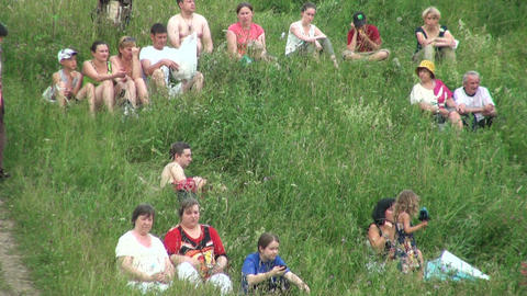 People have a rest on the grass Stock Video Footage