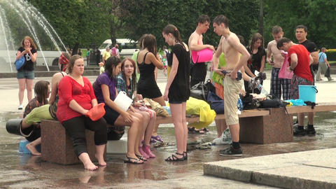 Crowds of young men in wet t-shirts Stock Video Footage