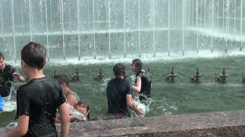 Young men bathe in the fountain Stock Video Footage