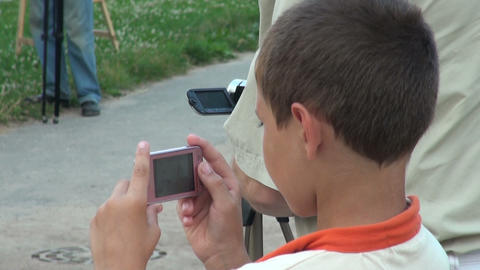 The boy takes on a mobile phone Stock Video Footage