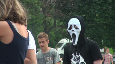 Guy in a terrible white mask Stock Video Footage
