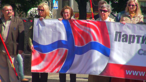 People with red-white flags at the rally Footage