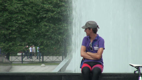 Man sits near the fountain Stock Video Footage