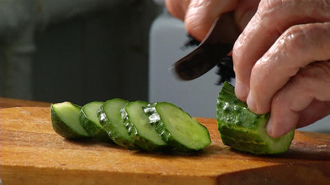 Cutting knife cucumber Stock Video Footage
